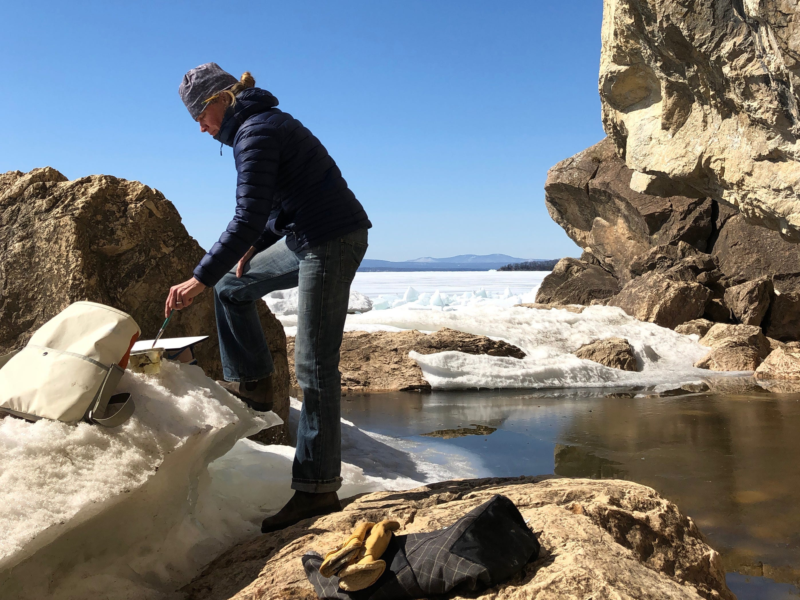 Burlington artist Katharine Montstream paints an icy landscape at Rock Point on March 26, 2019.