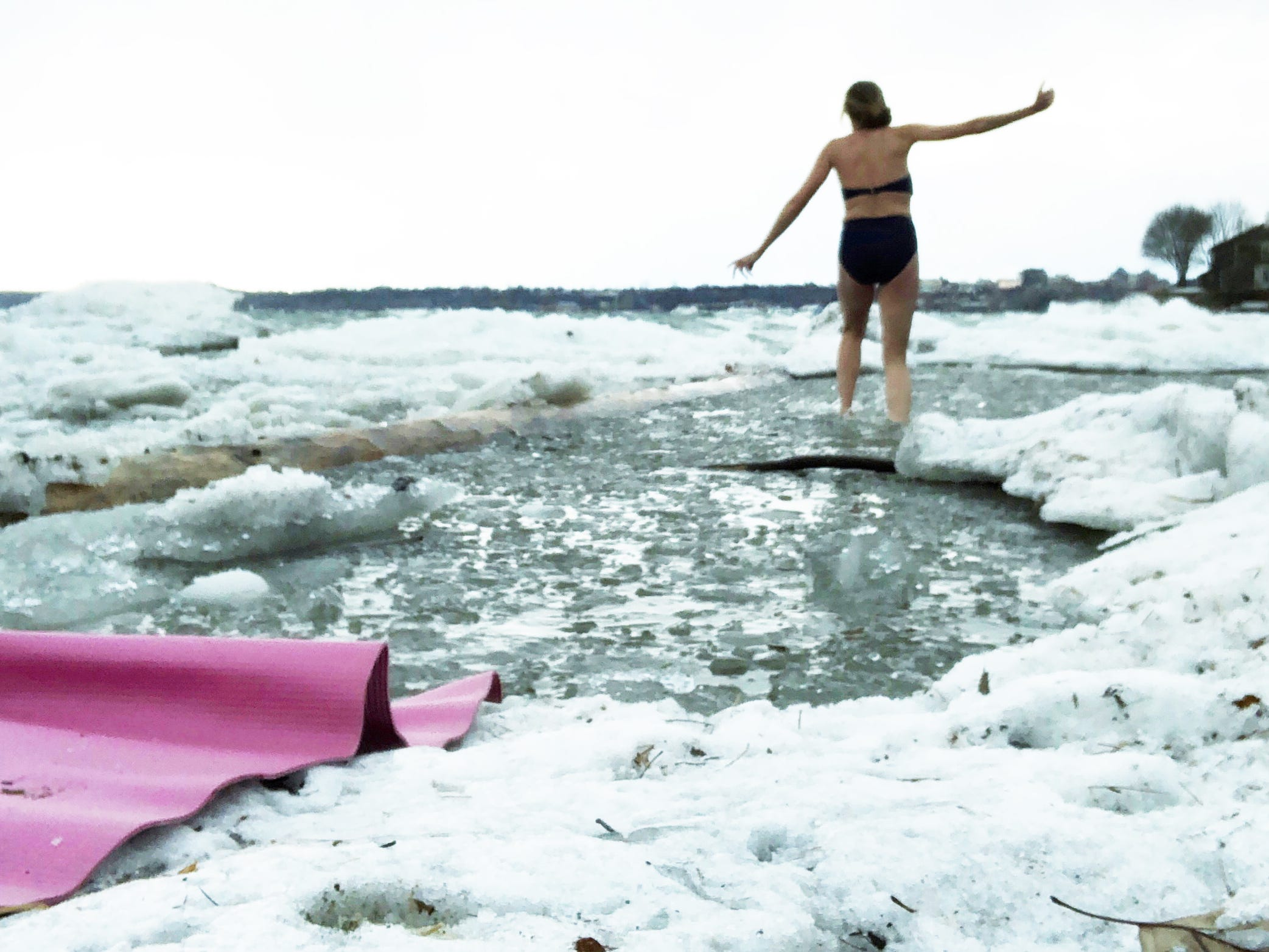 Katharine Montstream of Burlington wades through ice-water in Lake Champlain, en route to a waist-deep spot in which to fully immerse herself in late February 2019.