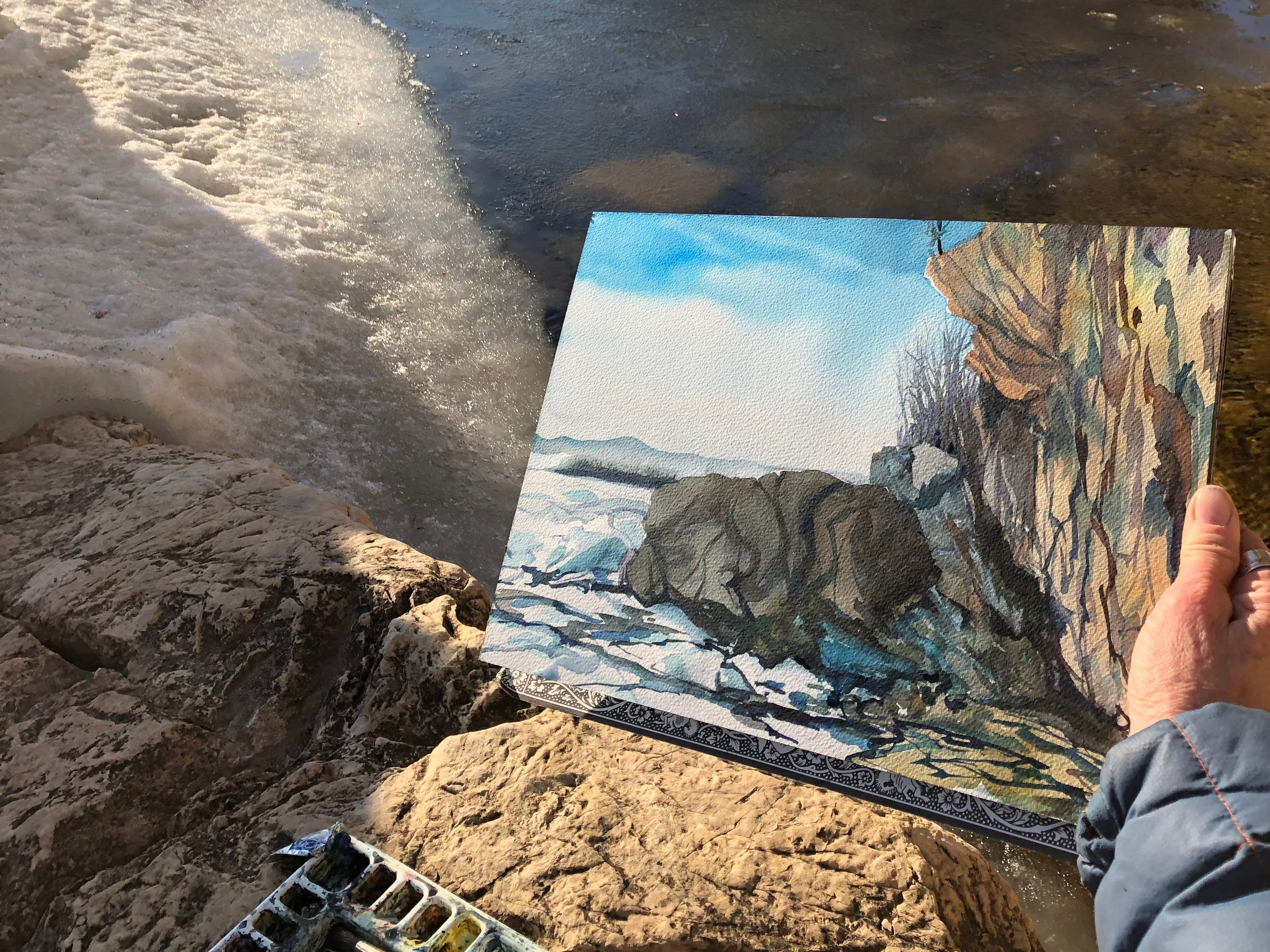 Burlington artist Katharine Montstream holds a watercolor painting she completed along the Lake Champlain coastline on March 27, 2019.
