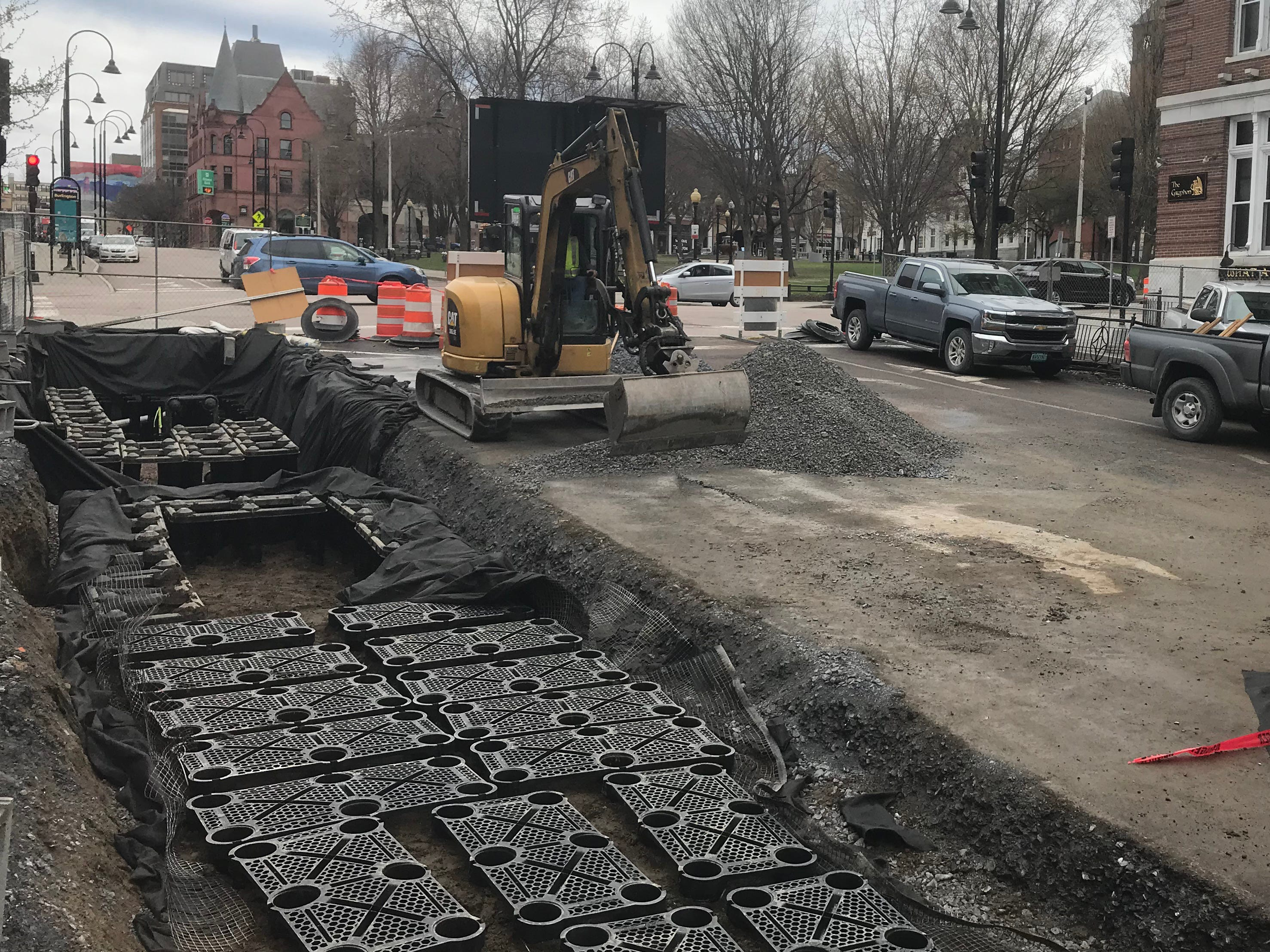 Underground tree planters (at left) that protect roots from compaction — and help manage downtown stormwater runoff — are installed on St. Paul Street in Burlington on April 25, 2019.