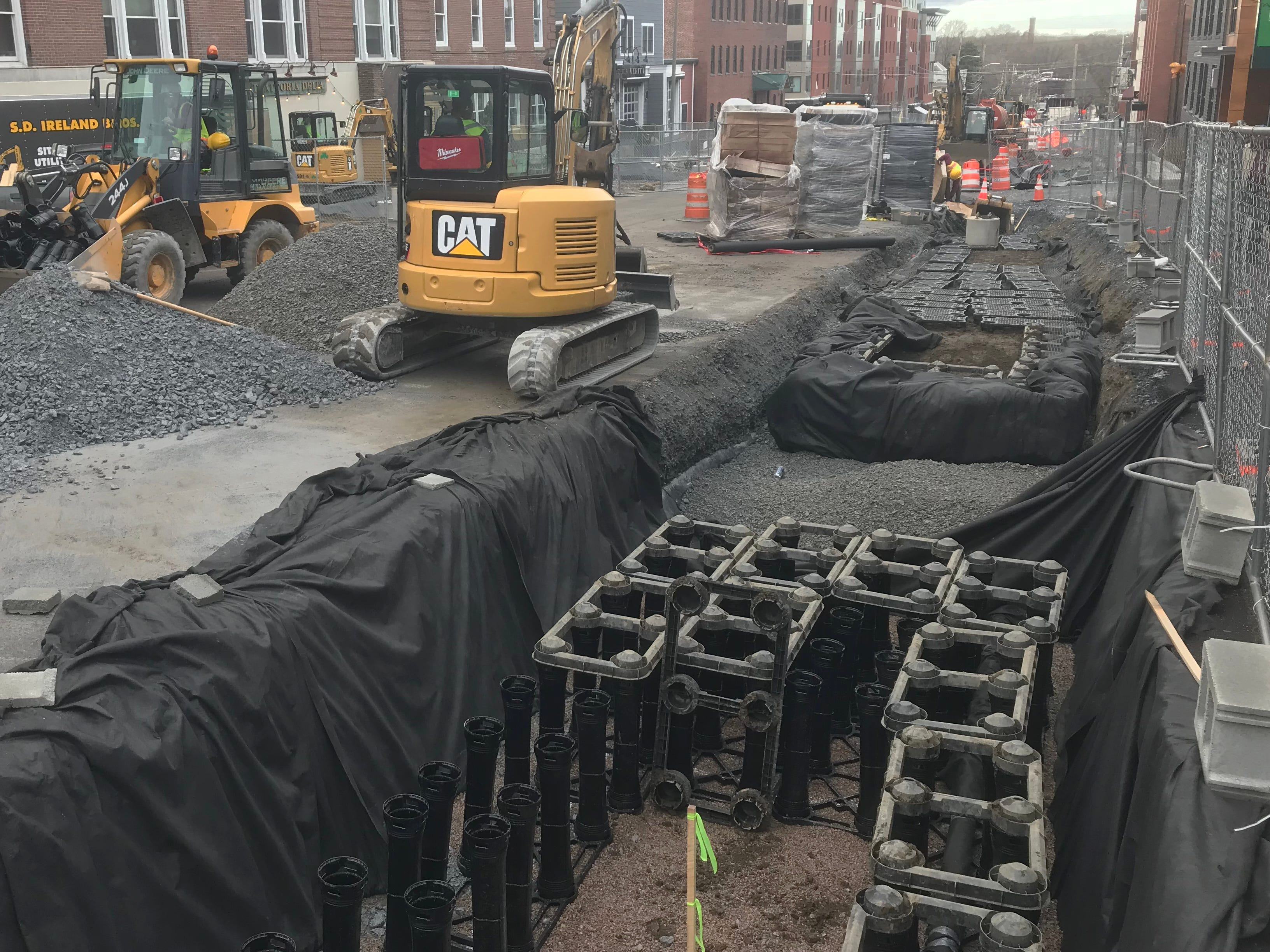 Underground tree planters (at right) that protect roots from compaction — and help manage downtown stormwater runoff — are installed on St. Paul Street in Burlington on April 25, 2019.