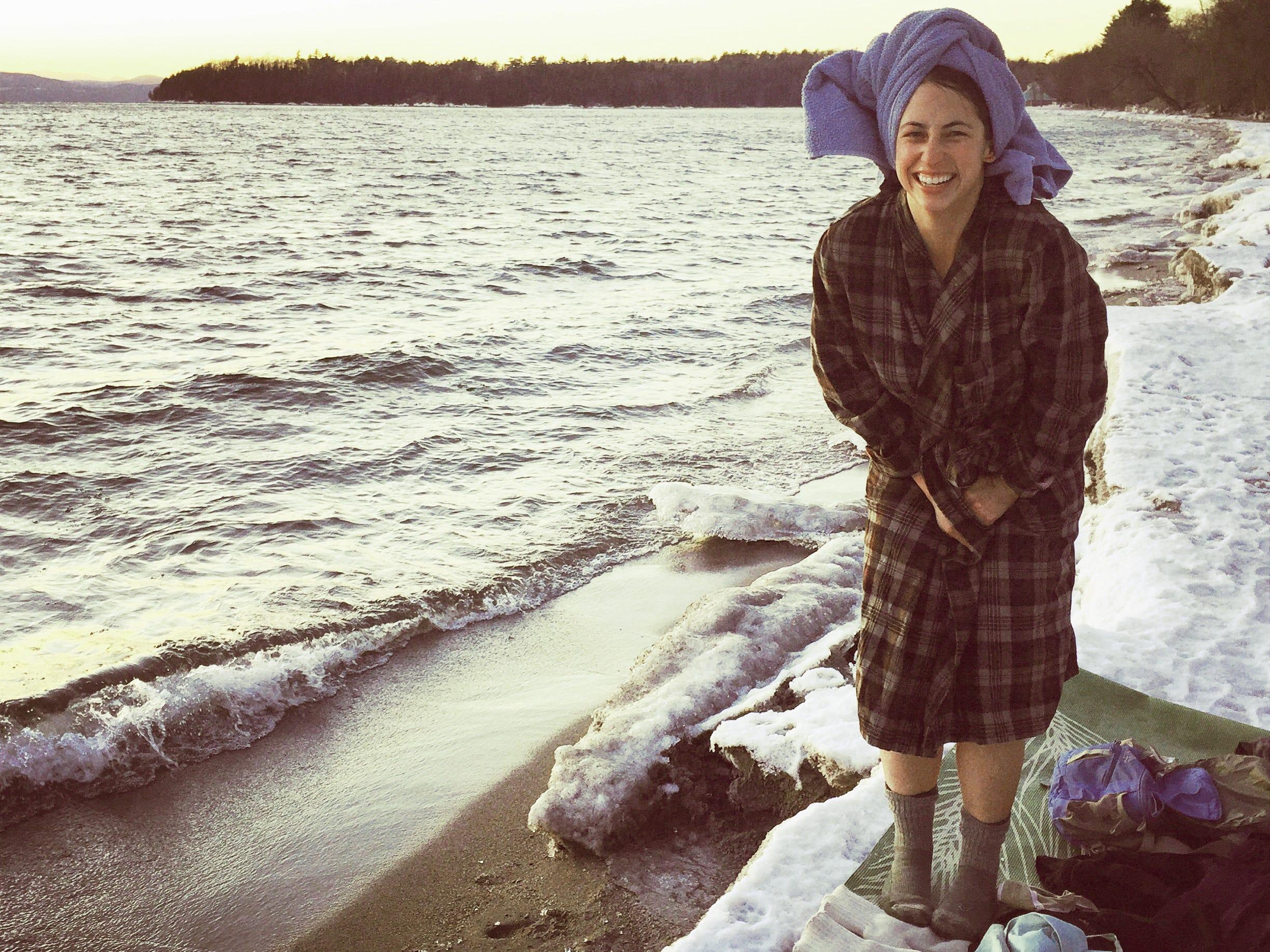 Elise Schadler bundles up after having taken a quick dip in Lake Champlain on Jan. 20, 2015.
