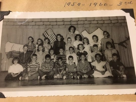 Three of the members of RE60 are in this photo of third graders at Sam Houston Elementary. Don Dunlap is in the front row, center, in the striped shirt. Keith Matthews (checkered shirt) is to the right of Dunlap. David Brown is in the back row, second from the right (Texas shirt).