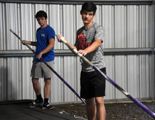 Tyler Rittiman, left, preps before pole vaulting with his brother, Trey, during practice, Wednesday, April 24, 2019. Both siblings qualified to state regionals for pole vaulting.