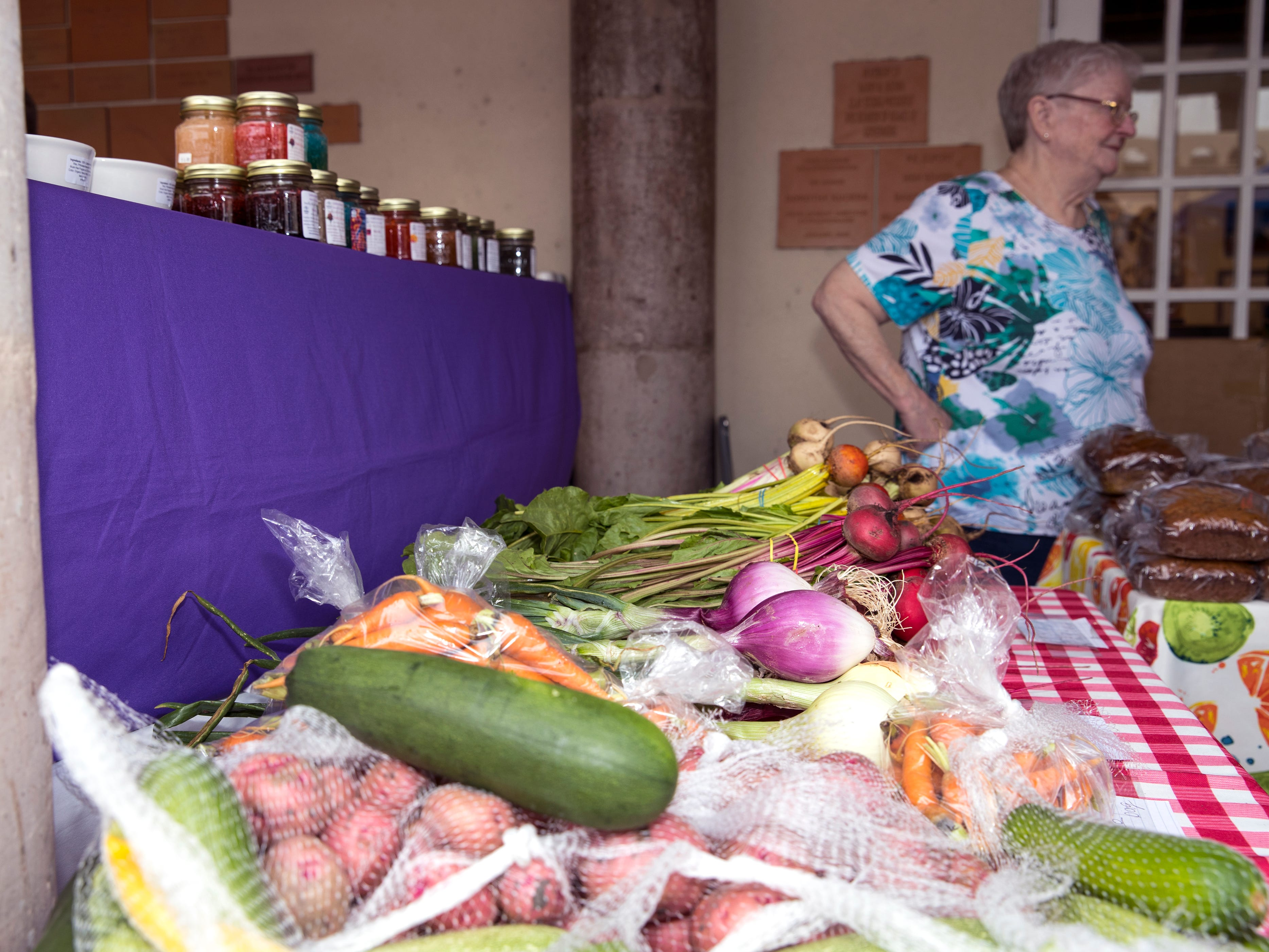 Nancy Weaver helps customers at the Corpus Christi Downtown Farmers Market on Wednesday, April 24, 2019. The farmers market offers a variety of seasonal produce, grass fed beef, pastured raised poultry, prepared goods such as roasted coffee, sweets and preserves and baked goods. It is open weekly on Wednesday from 5 to 8 pm at 100 N. Shoreline Blvd.