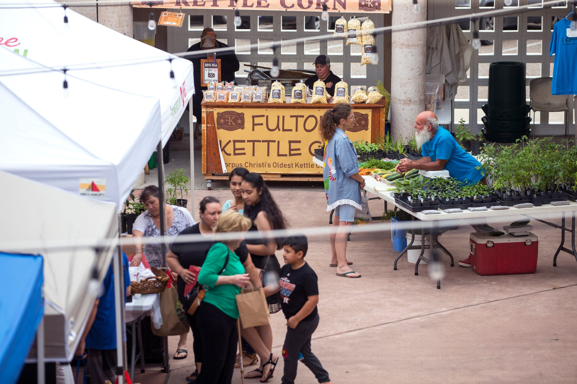 Shoppers visit the Corpus Christi Downtown Farmers Market on Wednesday, April 24, 2019. It offers a variety of seasonal produce, grass fed beef, pastured raised poultry, prepared goods such as roasted coffee, sweets and preserves and baked goods. It is open weekly on Wednesday from 5 to 8 pm at 100 N. Shoreline Blvd.