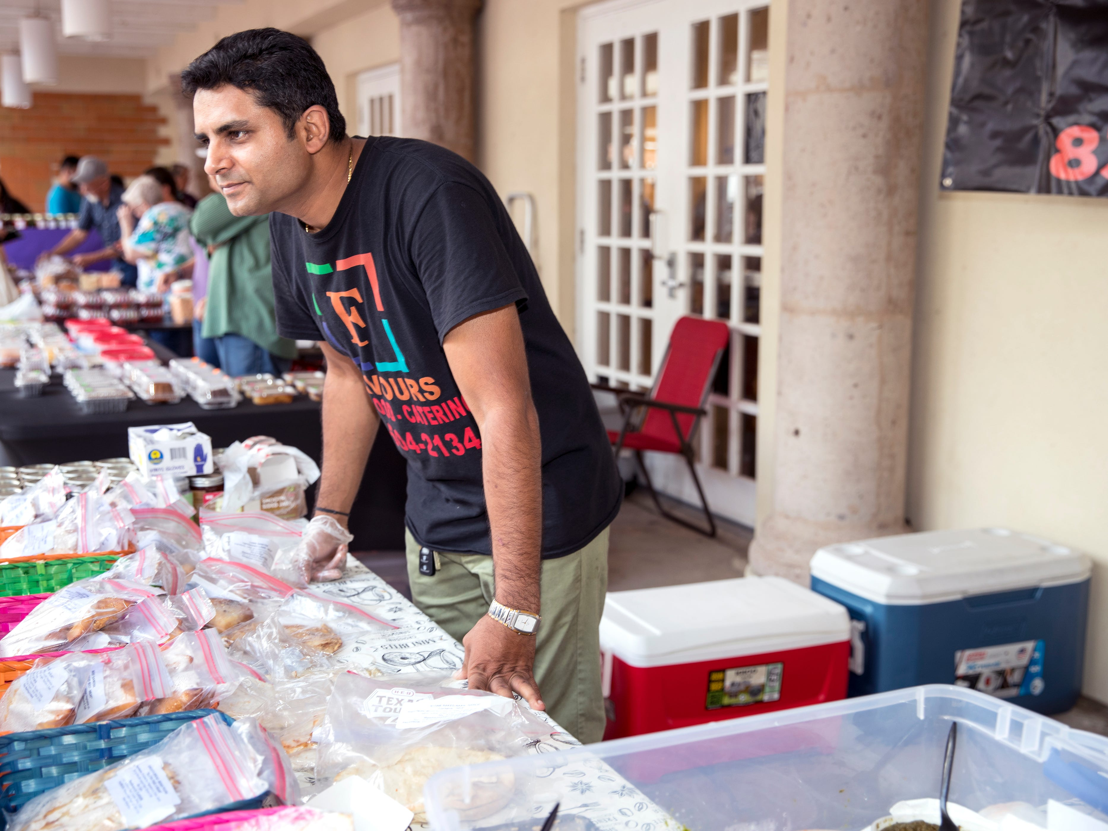 Chakshu Behl, with Flavours, talks with customers at the Corpus Christi Downtown Farmers Market on Wednesday, April 24, 2019. The farmers market offers a variety of seasonal produce, grass fed beef, pastured raised poultry, prepared goods such as roasted coffee, sweets and preserves and baked goods. It is open weekly on Wednesday from 5 to 8 pm at 100 N. Shoreline Blvd.