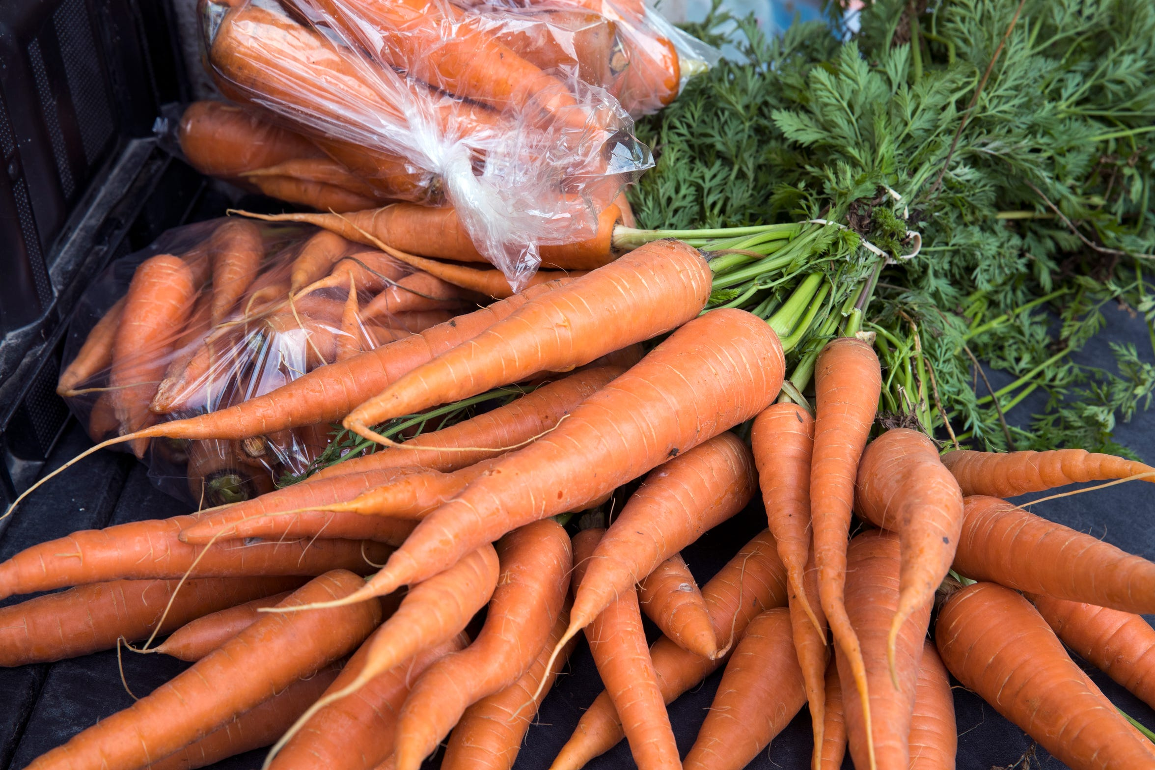 Locally-grown carrots is one example of what shoppers can buy at the Corpus Christi Downtown Farmers Market on Wednesday, April 24, 2019. The farmers market offers a variety of seasonal produce, grass fed beef, pastured raised poultry, prepared goods such as roasted coffee, sweets and preserves and baked goods. It is open weekly on Wednesday from 5 to 8 pm at 100 N. Shoreline Blvd.