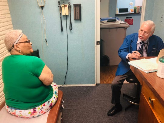 Maurice Grossman consults with his patient, Myrtle Denmon. He retired at the age of 91 after 63 years of practice in Corpus Christi as an internal medicine doctor.