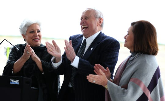 Rachel Denny Clow/Caller-Times Mayor Nelda Martinez (from left) jokes with Ed Hicks and his daughter, Debbie Hicks Layton, during the groundbreaking of Hicks Family Nissan on Wednesday, December 2, 2015. Ed Hicks died Thursday, just days shy of his 85th birthday.