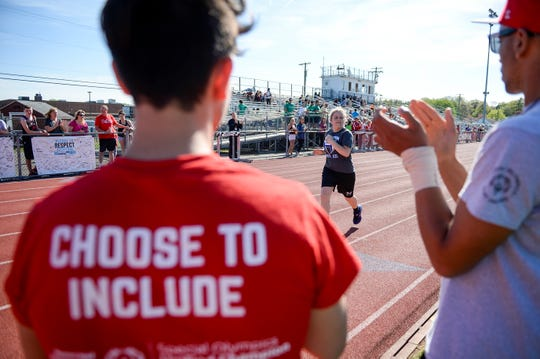 Competitors cross the finish line at the Delsea Unified Invitational in Franklin, N.J. Wednesday, April 24, 2019.