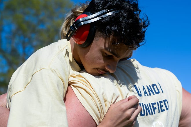 Brian Rivera, 16, of Clayton is hugged by his coach Nicole Rogers at the Delsea Unified Invitational on Wednesday.