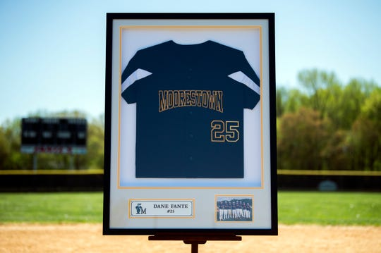 A frame containing Dane Fante's jersey and a team portrait is displayed at shortstop on the Moorestown baseball field Wednesday, April 24, 2019. Fante, a 2016 graduate, died in a car accident in February, 2018. The field will be renamed in his honor on May 10.