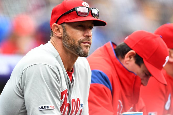 Apr 21, 2019; Denver, CO, USA; Philadelphia Phillies manager Gabe Kapler (19) before the start of the game against the Colorado Rockies at Coors Field. Mandatory Credit: Ron Chenoy-USA TODAY Sports