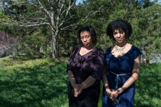 Danielle Colbert, left, and Aliya Robinson, founders of New Jersey Domestic Violence Movement, pose by the Burlington County Amphitheater in Westampton.