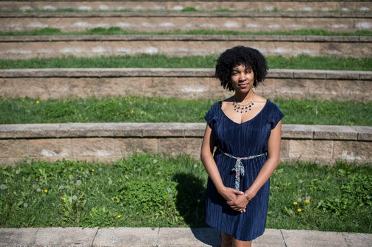 Aliya Robinson, co-founder of the New Jersey Domestic Violence Movement, poses by the Burlington County Amphitheater in Westampton.