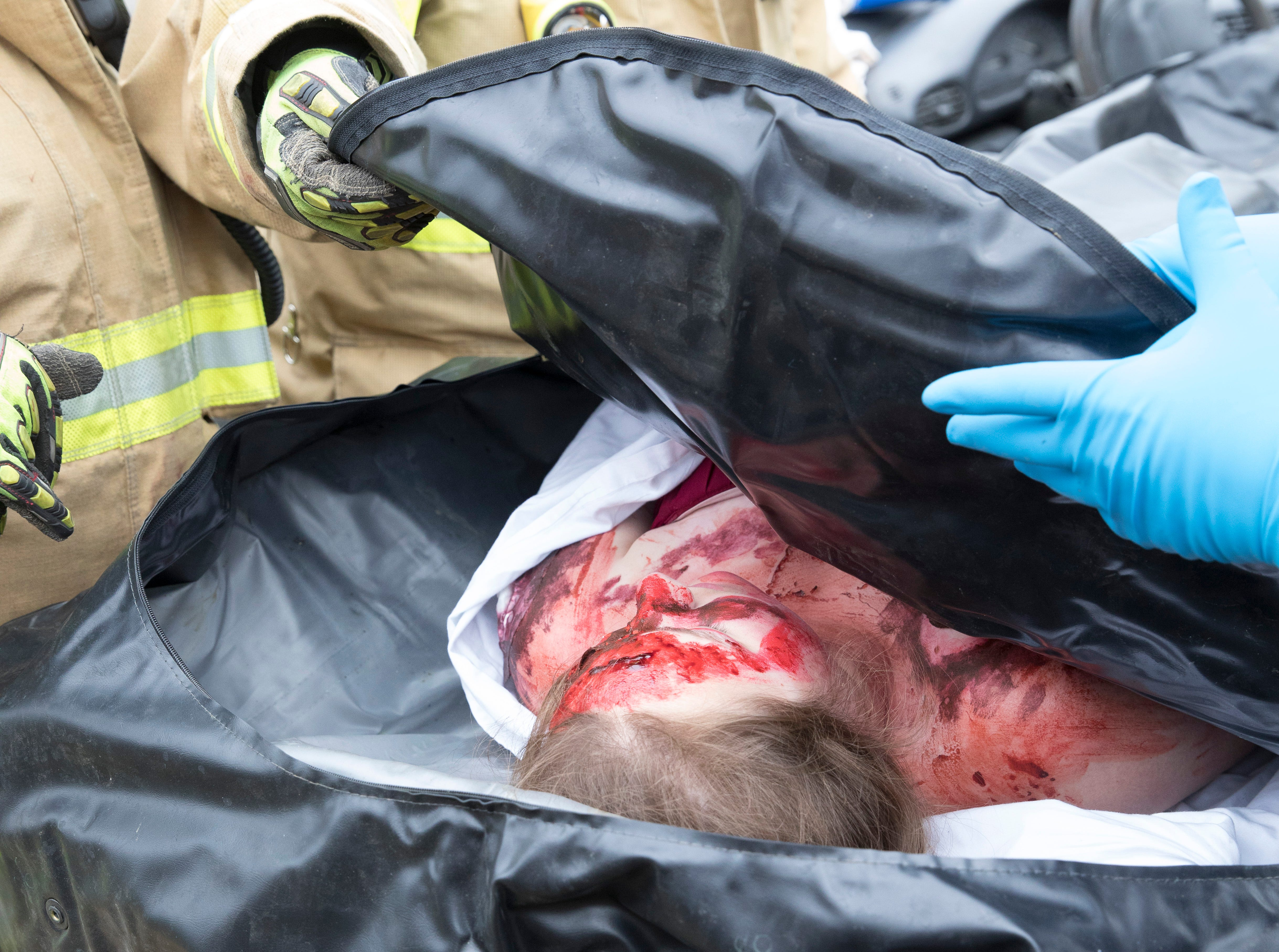 Gillian Just is declared dead during a mock crash at Paint Valley High School on Thursday, April 25, 2019, as part of the school's prom promise program. In cooperation with the Bainbridge EMS and Fire Department, Paxton EMS, Ohio State Ohio Patrol, and the Ross County Sheriff Department, students were shown the harsh realities drinking and driving can have.