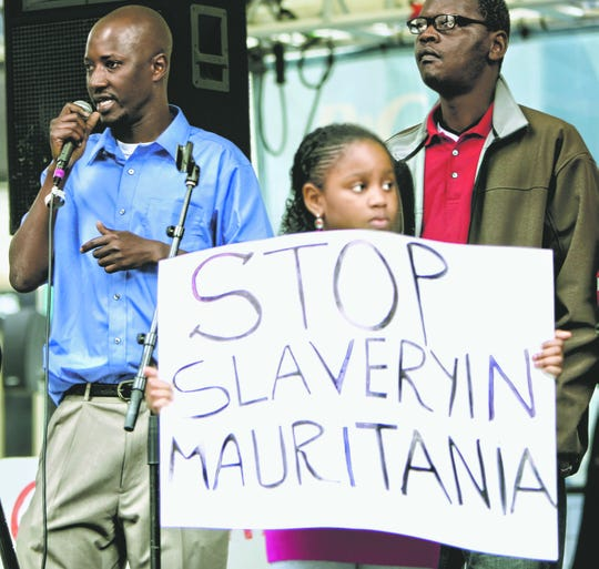Mauritanians and their supporters hold a rally at Fountain Square in 2012 to call for an end to slavery of Black Moor people in their native country.