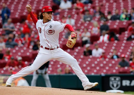 Cincinnati Reds starting pitcher Luis Castillo (58) delivers a pitch in the first inning of the MLB National League game between the Cincinnati Reds and the Atlanta Braves at Great American Ball Park in downtown Cincinnati on Thursday, April 25, 2019.