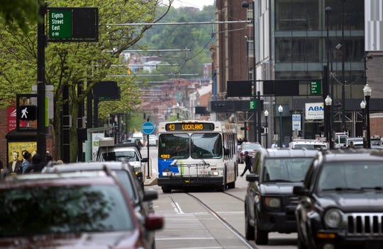 A Metro bus makes its way down Walnut Street in downtown Cincinnati toward Government Square, Thursday, April 25, 2019.