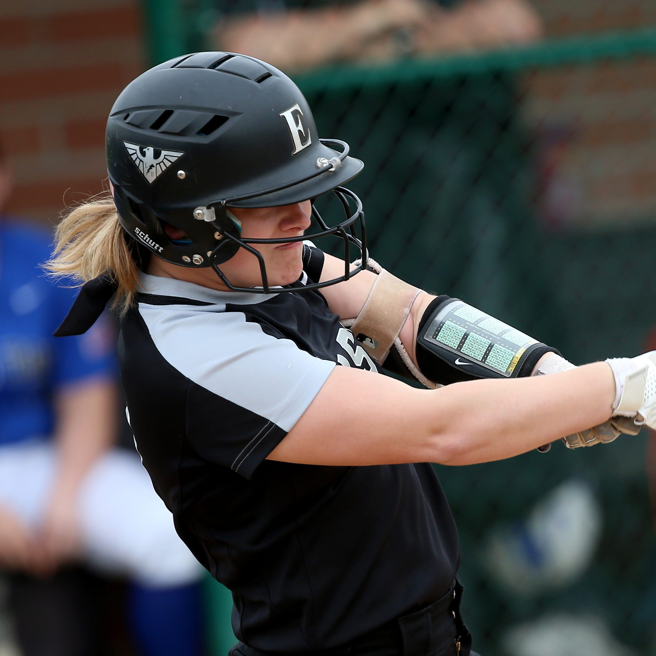 Lakota East batter Sydney Larson  swings during the Thunderhawks' softball game against Hamilton, Wednesday, April 24, 2019.