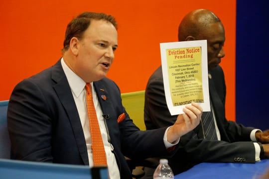 FC Cincinnati general manager Jeff Berding shows a fake eviction notice flyer that was passed out in the West End during a press conference to discuss the ongoing dispute over zoning and residences in the area around the future West End FC Cincinnati stadium at the team's main office in downtown Cincinnati on Thursday, April 25, 2019.