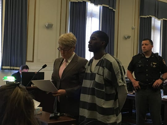 Styles Hummons, wearing a jail uniform, stands next to his attorney, M.J. Hugan, at an arraignment Thursday, April 25, 2019 in Hamilton County Common Pleas Court.