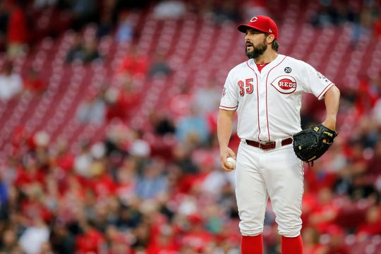 Cincinnati Reds starting pitcher Tanner Roark (35) gathers himself between pitches in the second inning of the MLB National League game between the Cincinnati Reds and the Atlanta Braves at Great American Ball Park in downtown Cincinnati on Wednesday, April 24, 2019