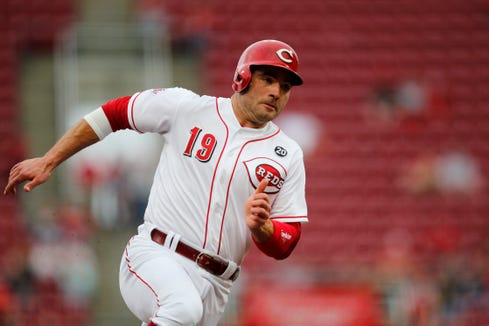 Cincinnati Reds first baseman Joey Votto (19) rounds third on an RBI single by Jesse Winker in the bottom of the first inning of the MLB National League game between the Cincinnati Reds and the Atlanta Braves at Great American Ball Park in downtown Cincinnati on Wednesday, April 24, 2019