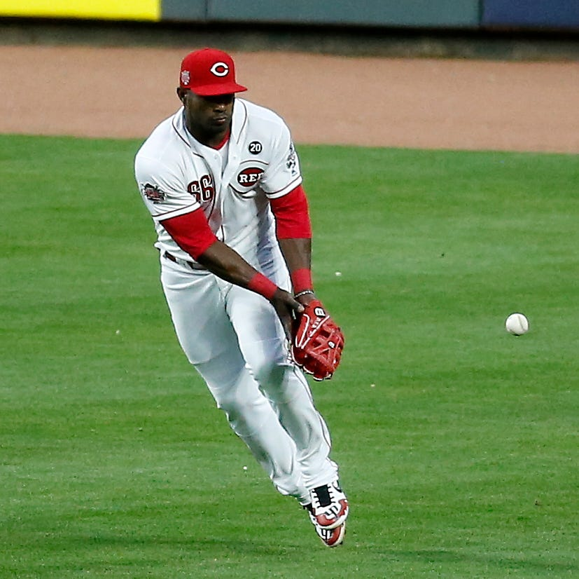 Yasiel Puig's error proves costly in Cincinnati Reds' 3-1 loss to Atlanta Braves
