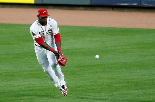 Cincinnati Reds right fielder Yasiel Puig (66) misplays a fly ball off the bat of Atlanta Braves right fielder Nick Markakis (22), allowing the go-ahead run to score in the fifth inning of the MLB National League game between the Cincinnati Reds and the Atlanta Braves at Great American Ball Park in downtown Cincinnati on Wednesday, April 24, 2019 The Reds fell 3-1 to the Braves.