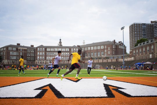 Teams from Bhutan and Mauritania compete in the annual refugee soccer tourney. Local teams with players who came here from around the world competed in 2016 at Withrow University High School.