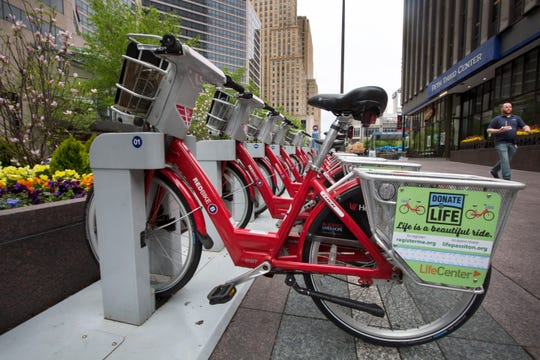 Red Bikes are parked near Fountain Square in downtown Cincinnati, Thursday, April 25, 2019.The ride share program has 442 bikes and 57 stations around the city.