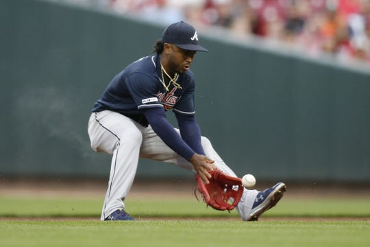 Atlanta Braves second baseman Ozzie Albies (1) fields a ground ball off the bat of Cincinnati Reds catcher Tucker Barnhart (16) in the first inning of the MLB National League game between the Cincinnati Reds and the Atlanta Braves at Great American Ball Park in downtown Cincinnati on Wednesday, April 24, 2019