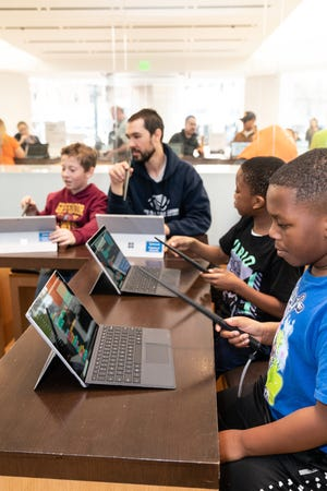 Children participating in a Microsoft Store camp for Design and Create Your Own Video Games with MakeCode Arcade.