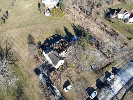 Aerial of the fire damage to a home in Raritan Township where a woman was rescued by three police officer who forced their way into the home.