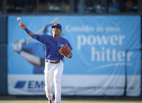 Iowa Cubs shortstop Addison Russell fires a throw to first base at Principal Park in Des Moines on Wednesday, April 24, 2019.