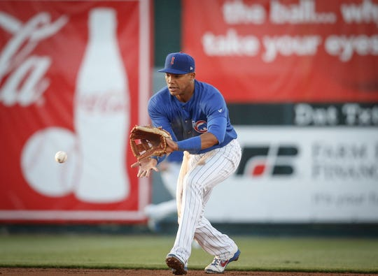 Iowa Cubs shortstop Addison Russell fields a ground ball against Nashville at Principal Park in Des Moines on Wednesday, April 24, 2019.