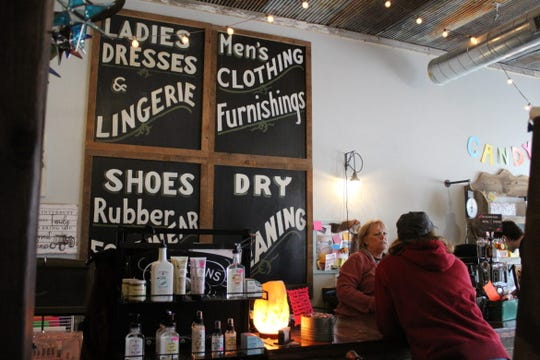 Ronda Fry, left, talks with Sharon Kistler at Grampa Jim's in Humeston, Iowa, on March 27.