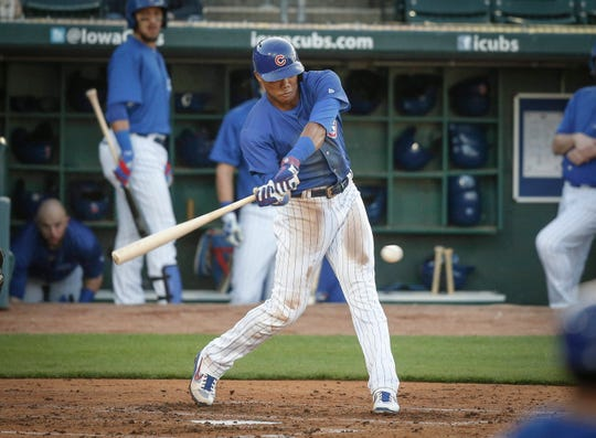 Iowa Cubs shortstop Addison Russell bears down on a pitch against Nashville at Principal Park in Des Moines on Wednesday, April 24, 2019.