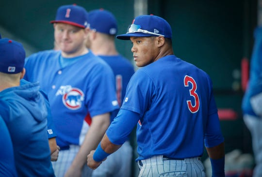 Iowa Cubs shortstop Addison Russell steps down into the dugout at Principal Park in Des Moines on Wednesday, April 24, 2019.
