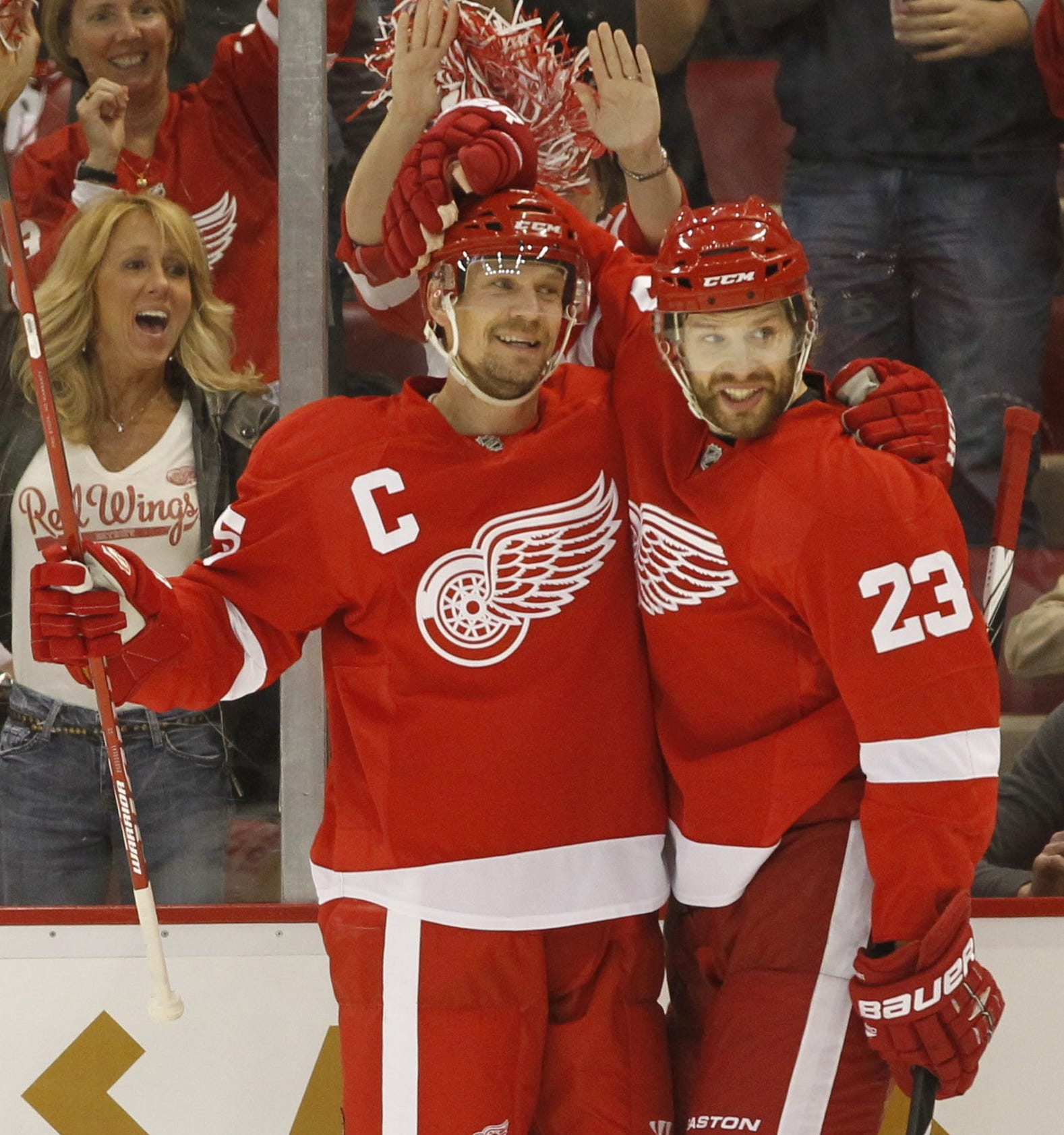 Red Wings defenseman Nicklas Lidstrom celebrates his first goal with Brad Stuart during the first period against the Sharks in Game 4 of their second-round series on May 6,  2011, at Joe Louis Arena.