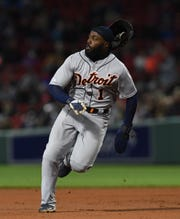 Detroit Tigers second baseman Josh Harrison runs to third base as his helmet falls off, during the seventh inning against the Boston Red Sox at Fenway Park, April 23, 2019, in Boston.