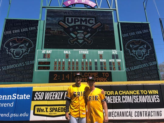 Alex Faedo, left, and Drew Carlton stand in front of the scoreboard after throwing a combined no-hitter at UPMC Park.