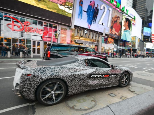 A camouflaged next generation Corvette travels near Times Square Thursday in New York.