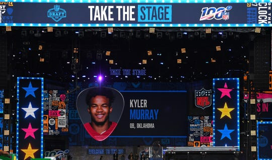 A photograph of Oklahoma quarterback Kyler Murray is displayed on the stage screen during a rehearsal as the top NFL prospects are announced the night before the NFL draft on Broadway in downtown Nashville, April 24, 2019.