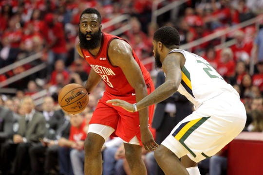Houston Rockets guard James Harden handles the ball against Utah Jazz forward Royce O'Neal during the first quarter in Game 5 of the first round of the playoffs at Toyota Center, April 24, 2019 in Houston.