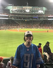"Hannah Pearson shows off her ""A'Shawn Robinson"" Detroit Lions jersey while attending a game at Fenway Park in Boston."