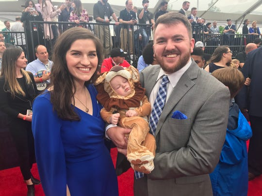 Hannah Pearson, pictured with her son, Samuel, and her husband, Cole, take part in NFL draft festivities on the red carpet in Nashville. Hannah could win Lions season tickets for life.
