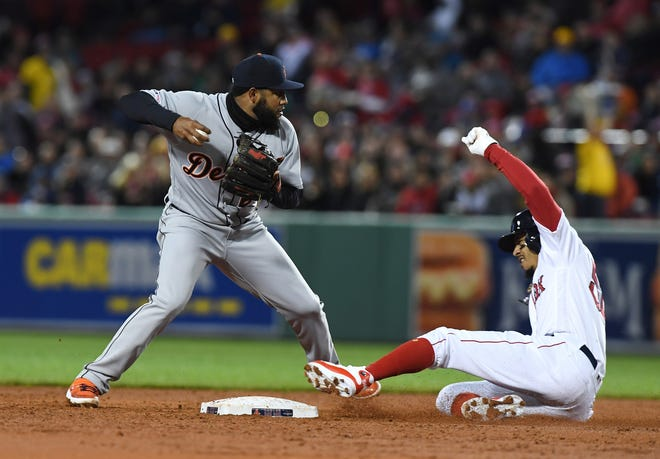 Detroit Tigers third baseman Ronny Rodriguez forces Boston Red Sox right fielder Mookie Betts at second base during the third inning at Fenway Park on April 23, 2019 in Boston.